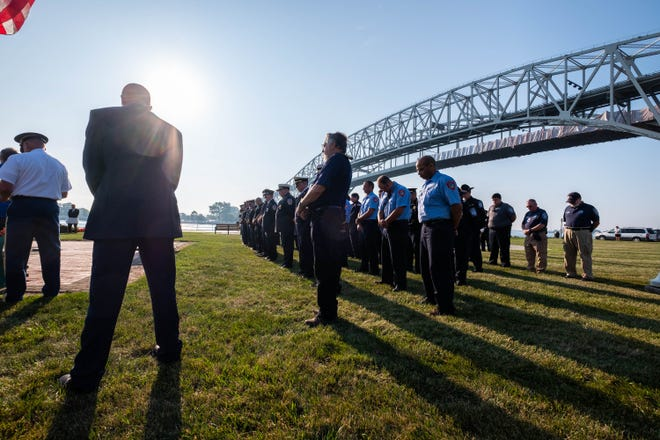 First responders stand at parade rest during a 9/11 memorial ceremony Wednesday, Sept. 11, 2019, at the International Flag Plaza in Port Huron.