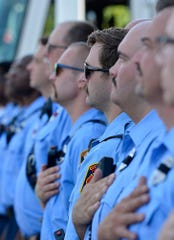 Members of the York City Department of Fire and Rescue stand for the National Anthem during a 9/11 remembrance ceremony at Mission BBQ, Wednesday, September 11, 2019.John A. Pavoncello photo
