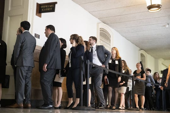 A crowd waits to enter the Pennsylvania Supreme Court at City Hall in Philadelphia, Wednesday, Sept. 11, 2019. The Pennsylvania Supreme Court is set to consider whether the death penalty amounts to cruel, arbitrary punishment that's too often reserved for black and poor defendants. (AP Photo/Matt Rourke)