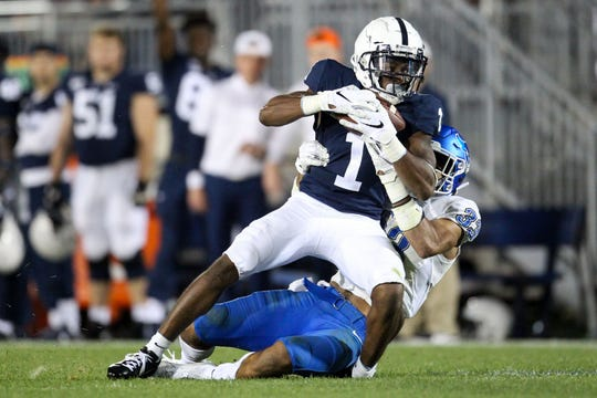 Sep 7, 2019; University Park, PA, USA; Penn State Nittany Lions wide receiver KJ Hamler (1) runs with the ball tacked by Buffalo Bulls safety Tyrone Hill (33) during the third quarter at Beaver Stadium. Penn State defeated Buffalo 45-13. Mandatory Credit: Matthew O'Haren-USA TODAY Sports