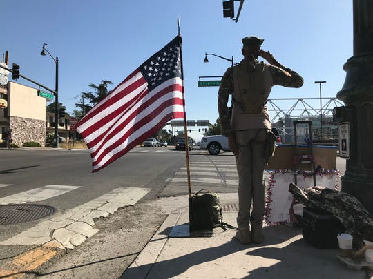 Cloudrainbowwalkerriverclan, 69, stands at the corner of Virginia Street and Eighth Street on Sept. 11, 2019 in honnor of the terrorist attacks 18 years ago.