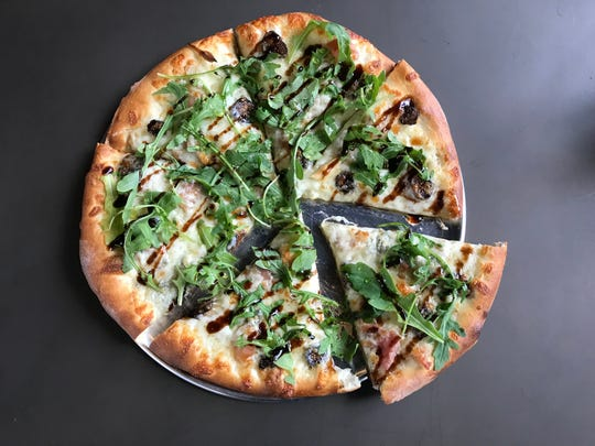 At the new Back Bay Pizza & Cocktails, the North End pizza (named for the Boston neighborhood) is topped with prosciutto, mozzarella, Gorgonzola, sweet pops of dried fig and a flurry of arugula.