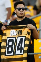 Pittsburgh Steelers fans don't forget what Antonio Brown put them through. Here a fan holds an old Brown jersey and changed the name on the back before the start of a preseason NFL football game between the Steelers and the Kansas City Chiefs this summer.