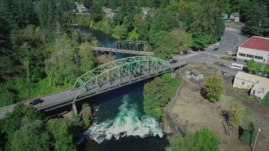 The historic railroad bridge, background, and the vehicular bridge over the Santiam River in Mill City will soon be getting a makeover. An $8.1 million U.S. Department of Transportation TIGER grant awarded to Mill City last year is the cornerstone of a $9.2 million project that will restore Mill City's historic railroad bridge, the vehicular bridge over the Santiam River and roads on 1st Avenue and Broadway Street.