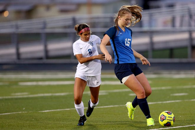 McNary's Samantha Alfano (15) leads Liberty's Sophia Magdaleno (6) with the ball during the Liberty vs. McNary girls soccer game at McNary High School in Keizer on Sep. 10, 2019.