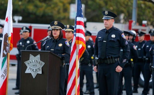 Salinas police Chief Adele Fresé praises Sgt. Cameron Murphy for his role in organizing officers in a Sept. 11, 2019, ceremony paying tribute to the victims of the terrorist attacks 18 years ago.