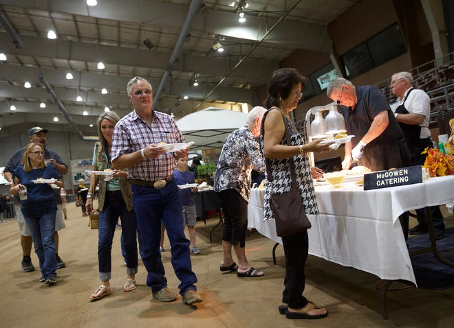 People attending the Taste of San Angelo make their way through the vendors Tuesday, September 10, 2019.