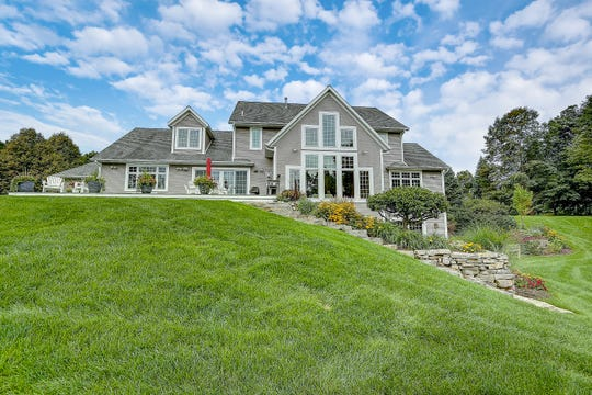 This beautiful home is for sale on the 5th hole of Quit-Qui-Oc golf club in Elkhart Lake.