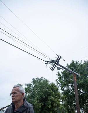 Power lines are bent after a devastating tornado hit Sioux Falls, Wednesday, Sept. 11, 2019.