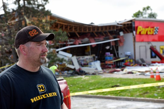 "Brett Wulff, general manager of Advance Auto Parts, looks out at the damage after a tornado caused ""total destruction"" of his business on Wednesday, September 11, in Sioux Falls."