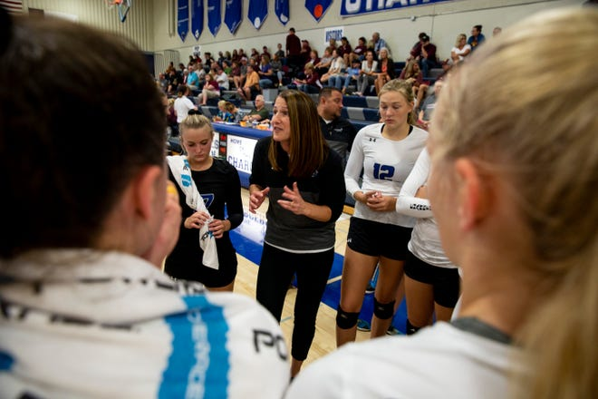 Coach Darci Wassenaar talks to the team between plays at Sioux Falls Christian on Tuesday, Sept. 10, 2019.