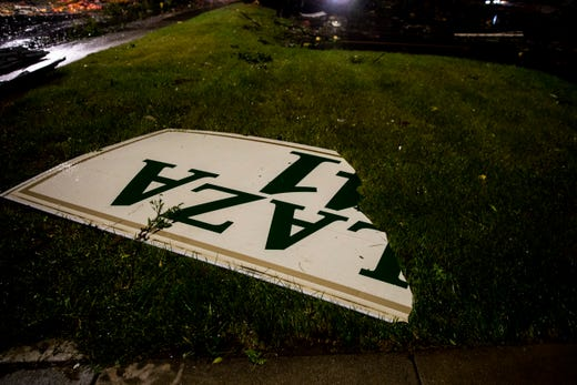 The Plaza 41 sign lays in the grass near 41st Street on Tuesday, Sept. 10, 2019.