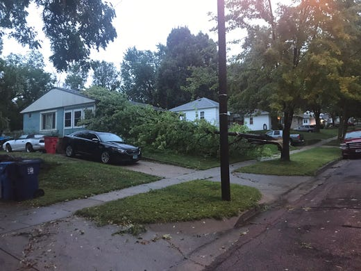 Downed tree blocking a home on South Hawthorne Avenue after overnight storms hit Sioux Falls Wednesday.