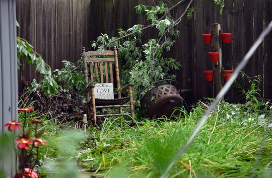 Ron Johnson's rocking chair sits in his wife, Lynette's, backyard despite tornado damage destroying nearly the entire yard on Wednesday, September 11.