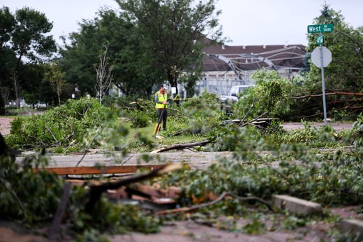 Crews work to clean the destruction left by a devastating tornado in Sioux Falls on Wednesday, Sept. 11, 2019.