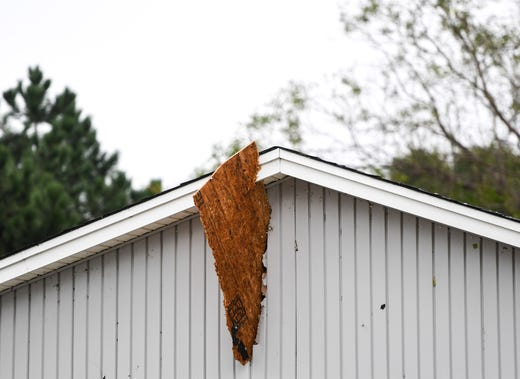 A piece of wood is lodged into a garage after a devastating tornado hit Sioux Falls on Tuesday, Sept. 10, 2019.