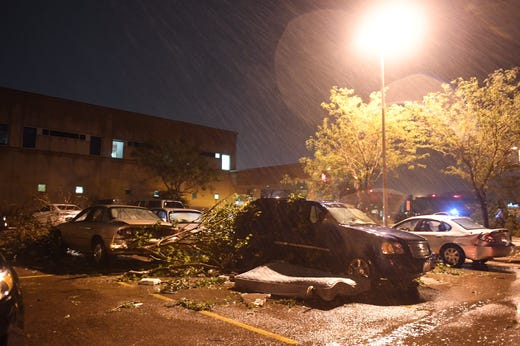 Avera Heart Hospital's entrance sustained significant damage. Many people are working to clear debris and majorly damaged parts of the building as well continuing to care for patients.