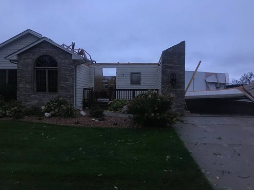 Damage to a home in southern Sioux Falls after a tornado hit Wednesday morning.