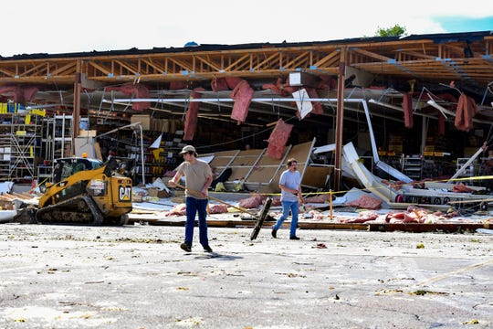 People work to clean up the parking lot surrounding the tornado-destroyed Advance Auto Parts on 41st Street on Wednesday, September 11, in Sioux Falls.