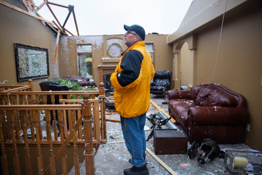 Matt Ditmanson stands in his living room after a devastating tornado hit Sioux Falls on Tuesday, Sept. 11, 2019. Ditmason built the house himself 20 years ago.