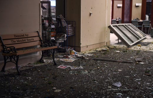 The Avera Heart Hospital lobby is covered in glass and debris after a tornado hit Sioux Falls on Tuesday night.