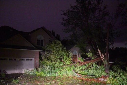 Massive downed tree limbs on St. Andrews Drive off Minnesota Ave on Tuesday night after a tornado hit Sioux Falls.