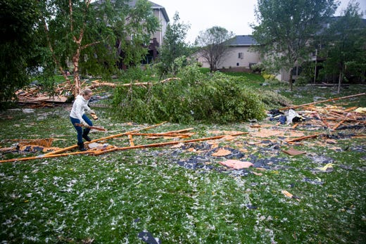 "Wendy Donelan cleans up her neighborhood after a devastating tornado hit, Tuesday, Sept. 10, 2019. ""This is the type of neighborhood where it's all hands on deck,"" Donelan said."