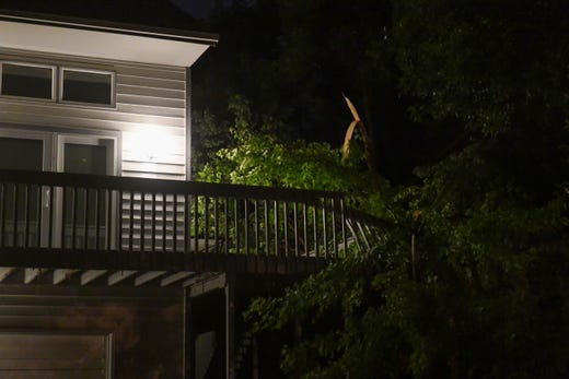 A residential home is damaged by a tornado Tuesday night.