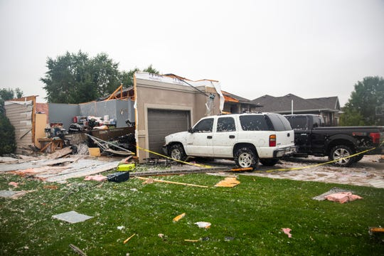 A home shows significant damage after a devastating tornado hit, Tuesday, Sept. 10, 2019.