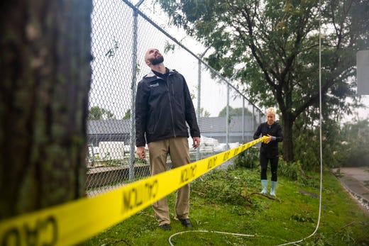 Whitnee Fester puts up caution tape outside of the Avera dome after a devastating tornado hit, Tuesday, Sept. 10, 2019.