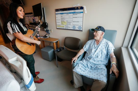 "Liz Moriondo and Russ Doughty, of Nixa, sing John Denver's song, ""Take Me Home, Country Roads"" at Cox South Medical Center on Monday, Sep. 9, 2019, in Springfield, Mo. Moriondo is starting the program, ""Musicians on Call"" at the hospital."