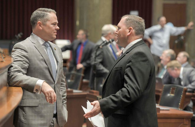 Missouri House Speaker Elijah Haahr, left, speaks with Majority Floor leader Rob Vescovo on the floor of the Missouri House on Wednesday, Sep. 11, 2019, in Jefferson City, Mo.