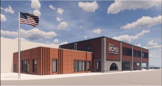 An artist rendering shows Boyd Elementary School from the southwest corner of Division Street.