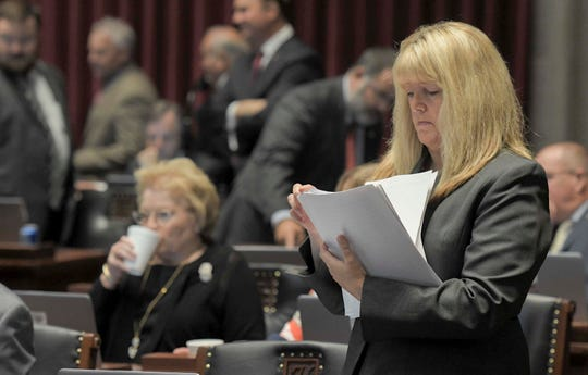 HB1 sponsor Rep. Becky Ruth shuffles through papers on the floor of the Missouri House during a special session on Wednesday, Sep. 11, 2019, in Jefferson City, Mo.