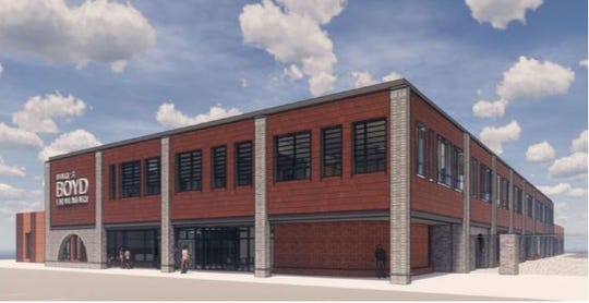 An artist rendering shows the exterior of Boyd Elementary from the corner of Division Street.