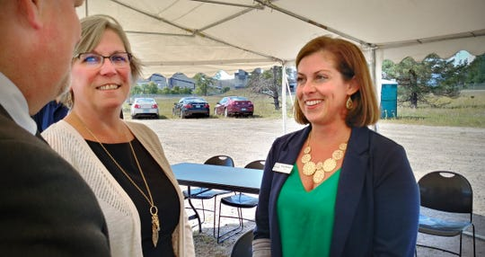 Becker Mayor Tracy Bertram visits with Patti Gartland, president of the Greater St. Cloud Development Corp., at the Becker Industrial Park on Friday, Sept. 6, 2019. Members of the House Capital Investment Committee heard requests involving the site.