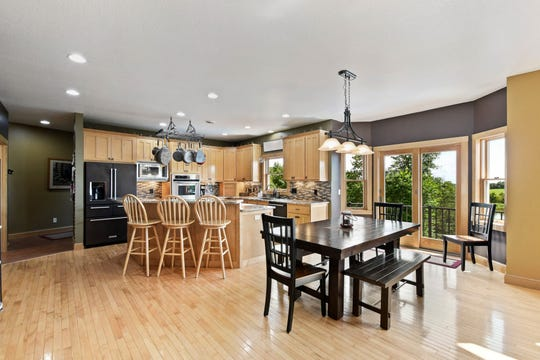 The kitchen is complete with granite countertops as well as two wall ovens and stainless steel and charcoal appliances.
