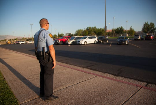 Lt. Ivor Fuller of the St. George Police Department stands outside Snow Canyon Middle School as students arrive Wednesday, Sept. 11, 2019. Local law enforcement will have an increased presence at area schools in response to a text thread that threatened a school shooting.