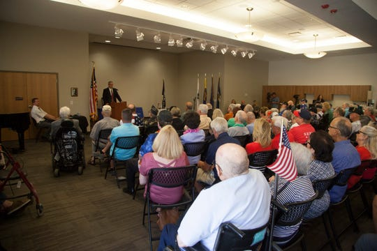 Southern Utah Veterans Home Administrator Jerry Olson speaks to a packed room Wednesday, Sept. 11, 2019.