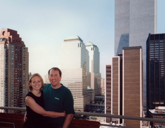 Christina Stanton poses with her husband, Brian Stanton, in front of the Twin Towers in New York.