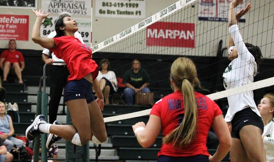 Wakulla junior Baby Cooksey goes up for a middle kill as Wakulla swept Lincoln 3-0 on Tuesday, Sept. 10, 2019.