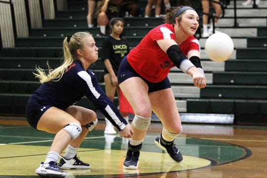 Wakulla's Madison Evans digs a ball in front of libero Clara Alford as Wakulla swept Lincoln 3-0 on Tuesday, Sept. 10, 2019.