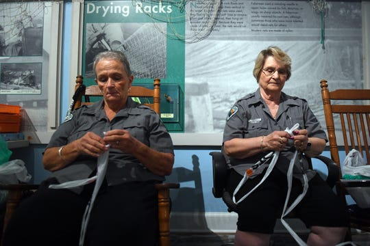 "Nannette Wall, (left) 67, and Ethel Ford, 70, sit in rocking chairs weaving strands of plastic bags, known as ""plarn"" Tuesday, Aug. 20, 2019, to be used as material for handbags, coasters and sleeping mats. Known as the ""Recycling Grannies"", Wall and Ford are volunteers at the Sebastian Inlet State Park and both agree the plastic they use will not negatively impact the park that they love. ""Just think about all those bags going into the environment,"" said Ford, who lives in Indian River County west of Vero Beach. ""These bags would wind up at the landfill, get into fishes' tummies, and the birds would get tangled in them. Not anymore."""
