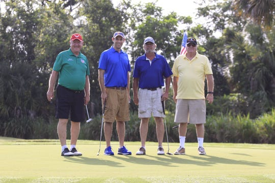 Veterans Council of Indian River County's Marty Zickert, left, Jason Brown and friends tee off at the 2018 Charity Golf Tournament.