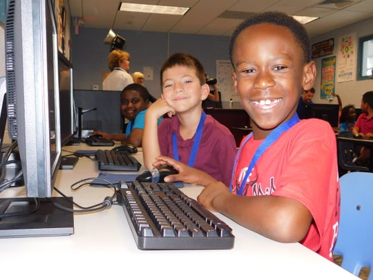 Members of the Boys & Girls Club of Vero Beach, a United Way of Indian River County funded partner, get ready for some computer time.