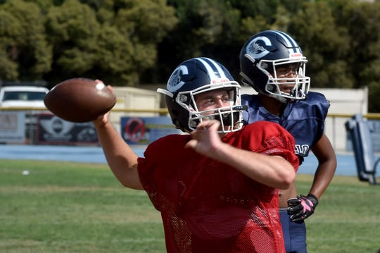 Quarterback James McNamara prepares to pass during a Camarillo High practice on Tuesday. McNamara leads an explosive offense for the Scorpions, who play Oxnard in a battle of 3-0 teams Friday night at Moorpark College.