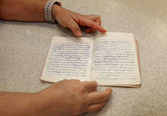 "Fariba Nafissi, pastry chef and owner of Zozo Baking in Simi Valley, shows a handwritten book of recipes given to her by her mother when Nafissi left Iran for the U.S. in the early 1990s. ""It can be tricky. She has things in there like, 'add a handful of flour',"" Nafissi says with a laugh."