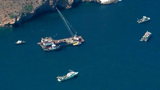 This photo from video provided by KABC-TV shows divers resuming their search Wednesday for the final missing victim who perished in the Conception boat fire off Santa Cruz Island.