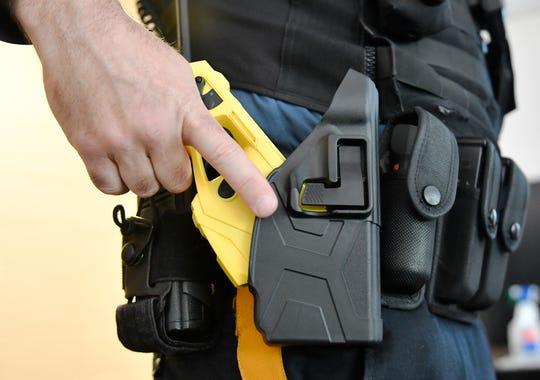 Vineland Police Sgt. Nick Sterchele secures his Taser into a holster.