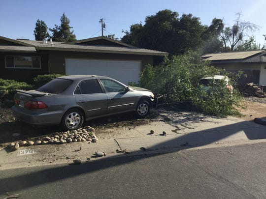 A Honda Accord drove through a yard and into a tree on Tuesday, Sept. 10, 2019.